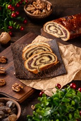 Sliced beigli cake, Hungarian walnut rolls on bamboo plate