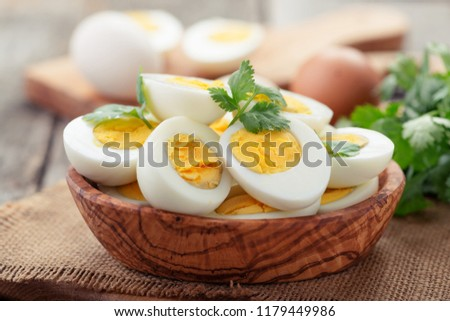Sliced boiled eggs,decorated with parsley leaves.