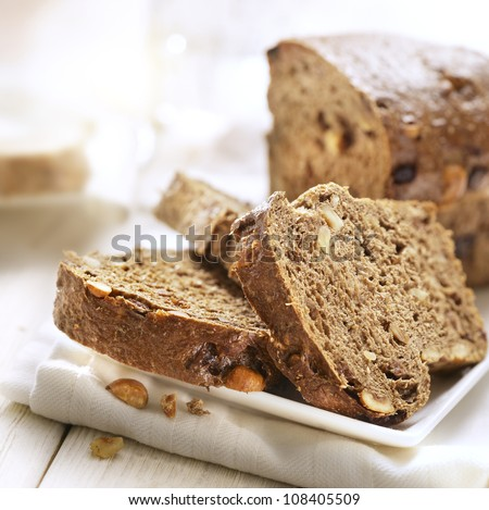 Sliced bread with nuts on a plate