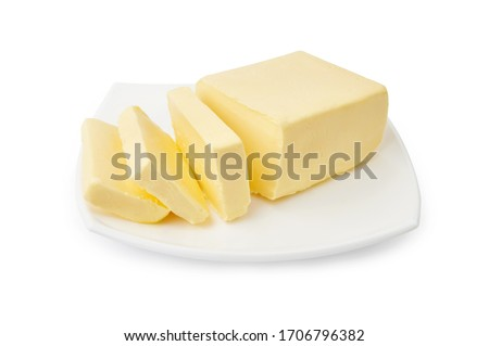 Sliced butter of piece butter on white plate isolated on white background. Foto stock ©