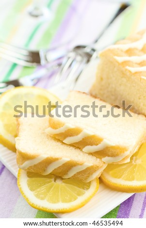 Sliced Cake On A Plate With Lemons