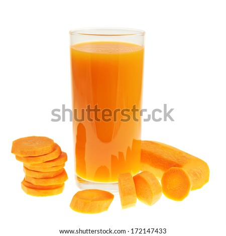 Sliced carrot pieces next to a juice bottle isolated over white background