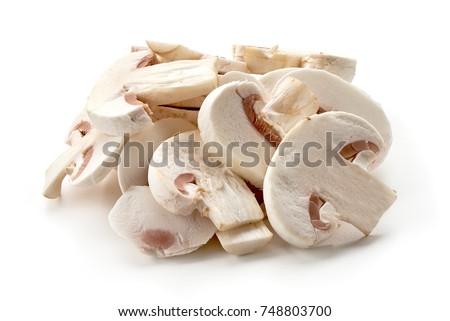 Sliced champignons, close-up, isolated on white background.