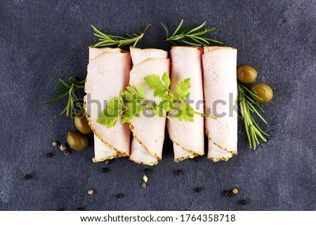 Sliced Chicken Breast fillet or turkey breast on background Сток-фото ©