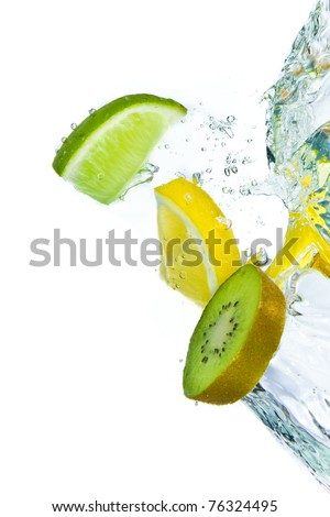 sliced citrus fruit with kiwi splashing isolated on white background