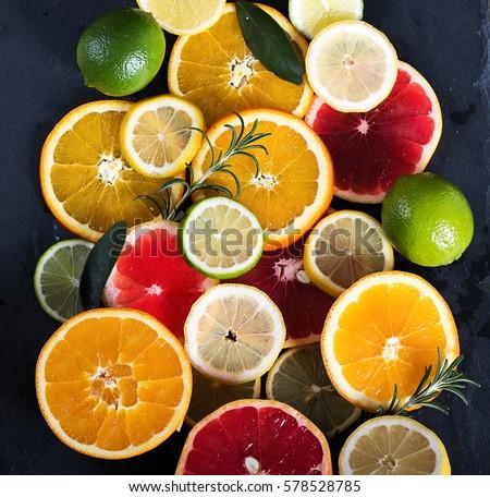 Sliced citrus fruits, vitamins, oranges, grapefruits, limes, juicy fruits background #578528785