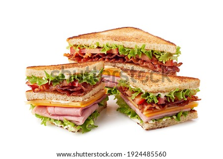 Sliced club sandwich on white Foto stock ©