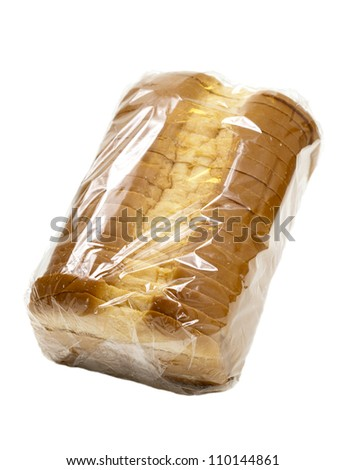 Sliced country white bread in plastic wrap; isolated on white background