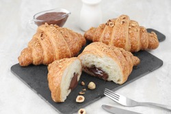 Sliced croissant with chocolate isolated