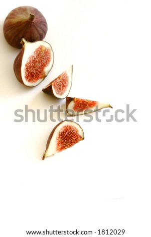 Sliced fig on white plate, isolated on white with copy space