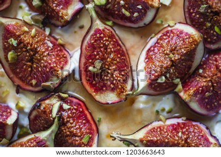 Sliced figs drizzled with wild honey