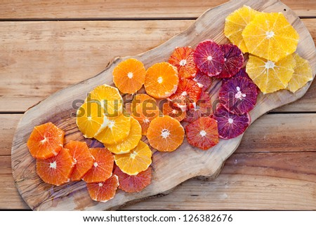 Sliced Fresh Juicy Oranges on cutting  board. 0