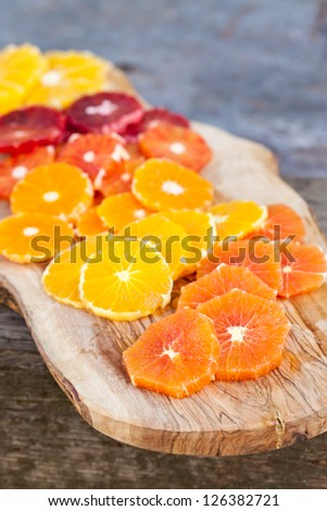 Sliced Fresh Juicy Oranges on cutting  board. Also available in horizontal format. - stock photo