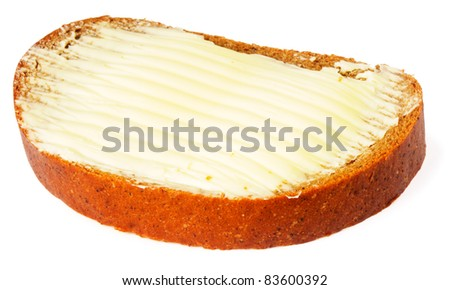 Sliced fresh rye-bread and butter over white background