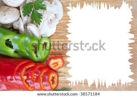 Sliced fresh veggies on bread board with empty space for text