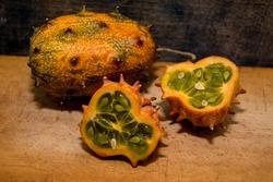 Sliced Fruit Kivano (Kiwano) melon on wooden background. Close up.