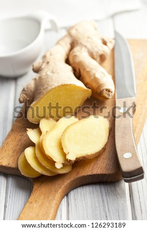 sliced ginger root on kitchen table