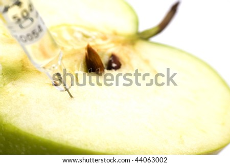 Sliced green apple injected with chemicals