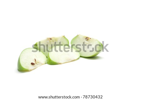 Sliced green apple isolated on white