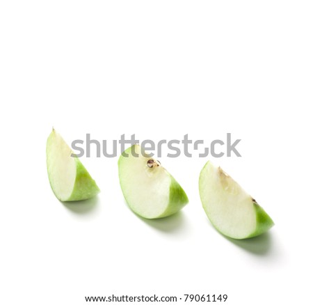 Sliced green apple on the white background