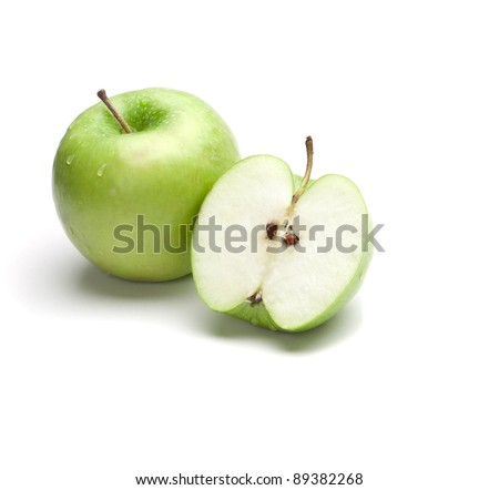 Sliced green apple with drops
