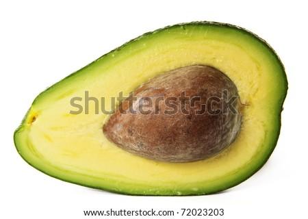 sliced green avokado half with seed