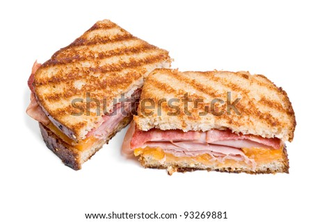 Sliced grilled turkey, bacon and cheese sandwich isolated on white