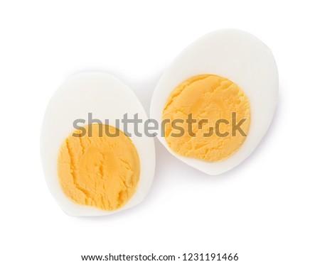 Sliced hard boiled egg on white background