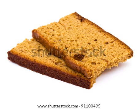 Sliced honey cake on white