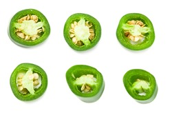 sliced jalapeno peppers isolated on white background. Green chili pepper. Capsicum annuum. top view