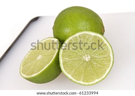 sliced lime an a white cutting board,