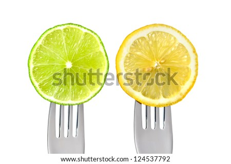 sliced lime and lemon of forks isolated against white background - stock photo