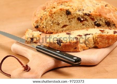 Sliced loaf of Irish Soda Bread on a  Cutting Board. - stock photo
