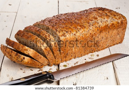 Sliced loaf of whole wheat bread with mixed seeds