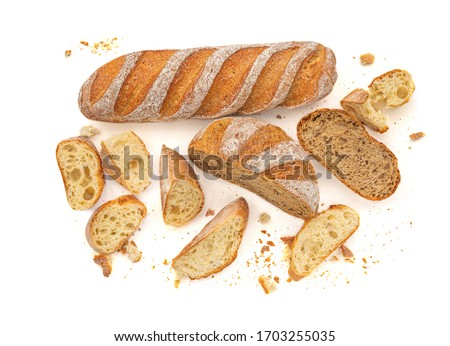 Sliced Multigrain rustic  bread isolated on a white background. Rye Bread with crusty loaves and crumbs. Top view. Flat lay. Bakery Food concept.
