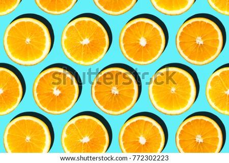 Sliced orange arranged in pattern.Top view.
