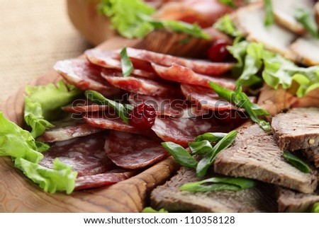 sliced peaces of meat on wooden tray