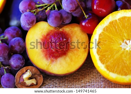 Sliced peach and orange, fruits on table