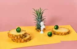 sliced pineapple mini status on pink background