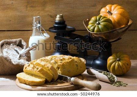 Sliced pumpkin bread in rustic farmhouse setting with old fashioned weighing scales
