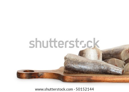 Sliced raw fish lying on wooden cutting board. Isolated on white background with clipping path
