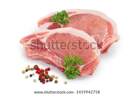 sliced raw pork meat with parsley and peppercorn isolated on white background