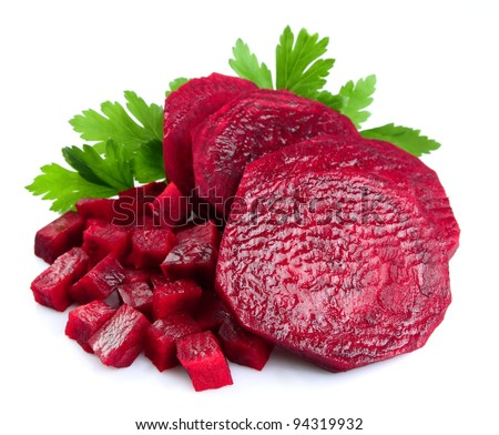 sliced red beets with parsley leafs on white background