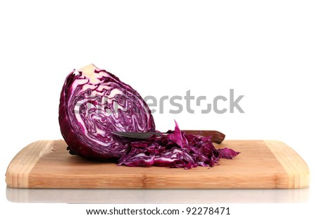 sliced ?red cabbage and knife on wooden chopping board isolated on white