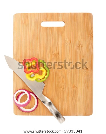 Sliced red onion and peppers on top of a cutting board isolated on white