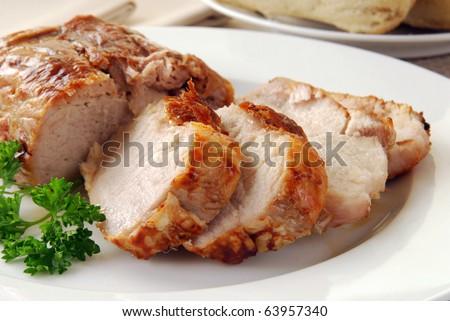 Sliced roast pork on a plate