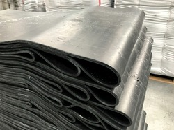 sliced rubber plates stacked on pallets
