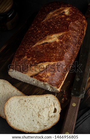 Sliced Rustic Bread on Rustic Cutting Board