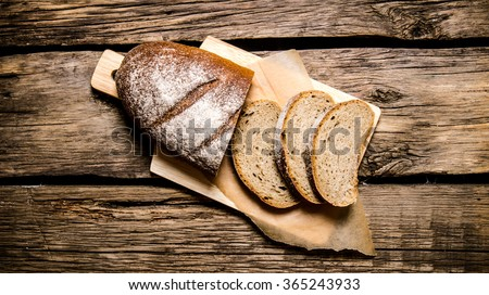 Sliced rye bread on a Board. On a wooden table. Top view Stock photo ©