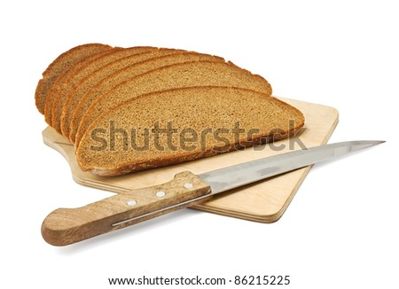 Sliced rye bread on a board with a knife isolated on white